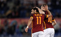 Calcio, Serie A: Roma vs Bologna. Roma, stadio Olimpico, 11 aprile 2016.<br /> Roma's Mohamed Salah, left, celebrates with teammate Francesco Totti after scoring during the Italian Serie A football match between Roma and Bologna at Rome's Olympic stadium, 11 April 2016.<br /> UPDATE IMAGES PRESS/Isabella Bonotto