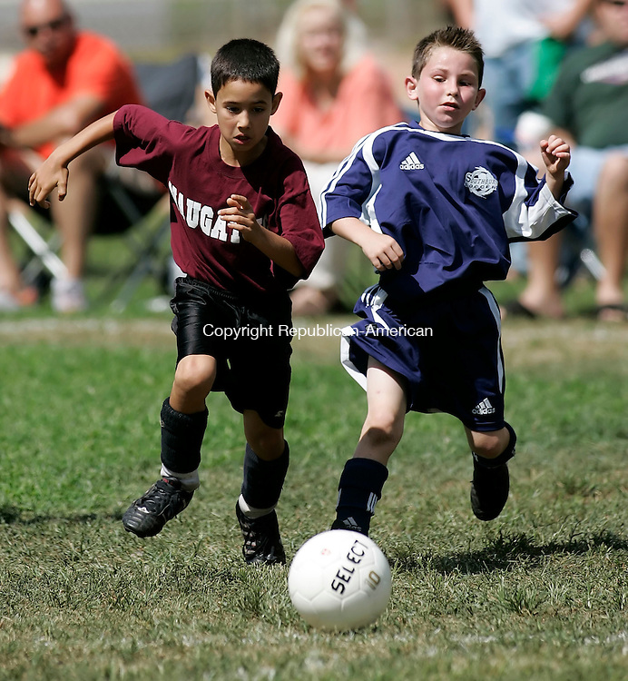 NAUGATUCK,  CT 04 September 2005 -090405BZ07- Naugatuck #4, Joshua Aviles, left, and Southbury #21, Matthew Cantor battle for the ball<br /> during play in the 2005 Naugatuck Savings Bank SPIN (Sao Paolo Invitational Naugatuck) Tournament at Rotary Field Sunday afternoon. <br />  Jamison C. Bazinet / Republican-American