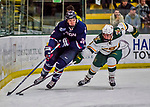 21 November 2017: University of Vermont Catamount forward Max Kaufman works against University of Connecticut Huskies forward Benjamin Freeman in the first period at Gutterson Fieldhouse in Burlington, Vermont. The Huskies defeated the Catamounts 4-1 in Hockey East play. Mandatory Credit: Ed Wolfstein Photo *** RAW (NEF) Image File Available ***