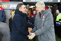 (L-R) Swansea manager Carlos Carvalhal greets Arsenal manager Arsene Wenger during the Premier League soccer match between Swansea City and Arsenal at the Liberty Stadium, Swansea, Wales, UK. Tuesday 30 January 2018