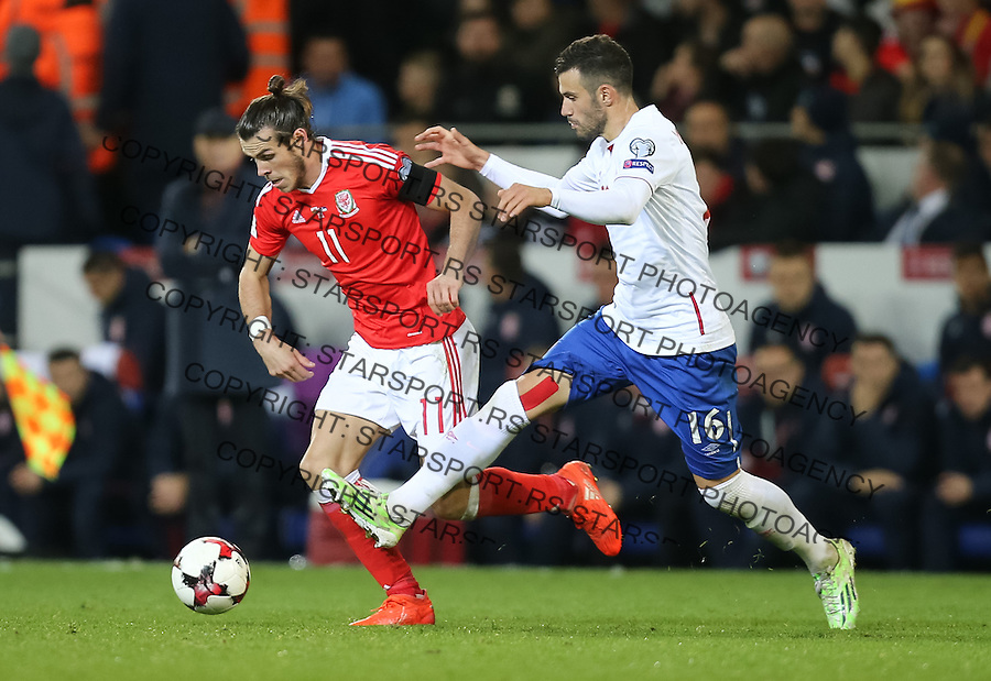 (copyright &amp; photo: STARSPORT)<br /> 12.11.16 - Wales v Serbia, FIFA World Cup Qualifier 2018 - Gareth Bale of Wales is challenged by Luka Milivojevic of Serbia
