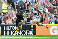 Christian Wade of London Wasps accelerates away from Matt Hopper of Harlequins during the Aviva Premiership match between London Wasps and Harlequins at Twickenham on Saturday 1st September 2012 (Photo by Rob Munro).