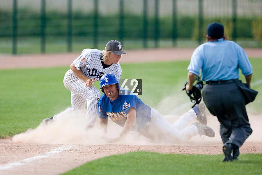 12 Aug 2007: Sylvain Hervieux slides into third base as Luc Piquet tags him during game 5 of the french championship finals between Templiers (Senart) and Huskies (Rouen) in Chartres, France. Huskies defeated Templiers 9-8 to win their fourth french championship.