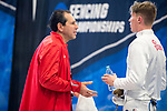 UNIVERSITY PARK, PA - MARCH 25: St. John's University coach Boris Vaksman talks with Sean White during the finals in the epee competition during the Division I Men's Fencing Championship held at the Multi-Sport Facility on the Penn State University campus on March 25, 2018 in University Park, Pennsylvania. (Photo by Doug Stroud/NCAA Photos via Getty Images)