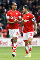 Alex Mowatt of Barnsley (R) celebrates his goal with team mate Toby Sibbick (L) during the Sky Bet Championship match between Barnsley and Swansea City at Oakwell Stadium, Barnsley, England, UK. Saturday 19 October 2019
