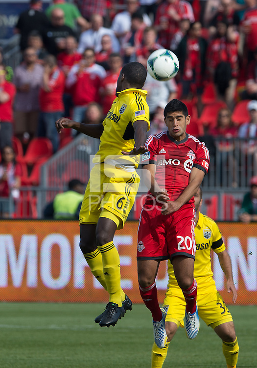 18 May 2013: Toronto FC midfielder Matias Laba #20 and Columbus Crew midfielder Tony Tchani #6 in action during the first half in an MLS game between the Columbus Crew and Toronto FC at BMO Field in Toronto, Ontario Canada....