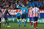 Referee Stark shows a yellow card to Olympiacos´s Fuster during Champions League soccer match between Atletico de Madrid and Olympiacos at Vicente Calderon stadium in Madrid, Spain. November 26, 2014. (ALTERPHOTOS/Victor Blanco)