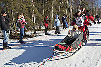 Paul F Gebhardt and team run past spectators on the bike/ski trail during the Anchorage ceremonial start during the 2014 Iditarod race.<br /> Photo by Britt Coon/IditarodPhotos.com