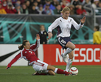 06 November,  2004.  USWNT forward Cindy Parlow (12) avoids the tackle of  Bettina Falk (5) of Denmark at  Lincoln Financial Field in Philadelphia, Pa.