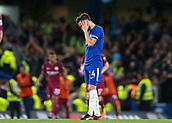 30th September 2017, Stamford Bridge, London, England; EPL Premier League football, Chelsea versus Manchester City; Cesc Fabregas of Chelsea dejected after Kevin De Bruyne of Manchester City celebrates in front of the Manchester City fans after scoring his sides 1st goal in the 62nd minute to make it 0-1