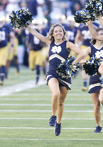 September 06, 2014:  Notre Dame cheerleader during NCAA Football game action between the Notre Dame Fighting Irish and the Michigan Wolverines at Notre Dame Stadium in South Bend, Indiana. Notre Dame defeated Michigan 31-0.