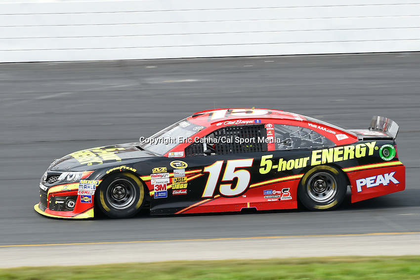 July 13, 2014 - Loudon, New Hampshire, U.S. - Sprint Cup Series driver Clint Bowyer (15) drives in the NASCAR Sprint Cup Series Camping World RV 301 race held at the New Hampshire Motor Speedway in Loudon, New Hampshire. Eric Canha/CSM