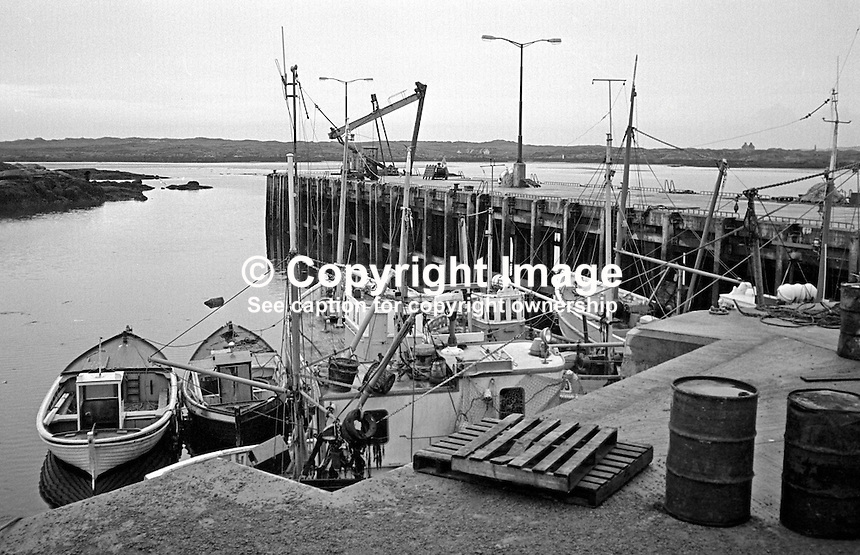 Harbour, Burtonport, Co Donegal, Rep of Ireland, 197611230477b.<br /> <br /> Copyright Image from Victor Patterson,<br /> 54 Dorchester Park, <br /> Belfast, UK, BT9 6RJ<br /> <br /> t1: +44 28 9066 1296 (from Rep of Ireland 048 9066 1296)<br /> t2: +44 28 9002 2446 (from Rep of Ireland 048 9002 2446)<br /> <br /> m: +44 7802 353836<br /> <br /> e: victorpatterson@me.com<br /> www.victorpatterson.com<br /> <br /> Please see my Terms and Conditions of Use at www.victorpatterson.com. It is IMPORTANT that you familiarise yourself with them.<br /> <br /> Images used on the Internet must be visibly watermarked i.e. &copy; Victor Patterson<br /> within the body of the image and copyright metadata must not be deleted. Images <br /> used on the Internet have a size restriction of 4kbs and will be chargeable at current<br />  NUJ rates unless agreed otherwise.<br /> <br /> This image is only available for the use of the download recipient i.e. television station, newspaper, magazine, book publisher, etc, and must not be passed on to any third <br /> party. It is also downloaded on condition that each and every usage is notified within 7 days to victorpatterson@me.com<br /> <br /> The right of Victor Patterson to be identified as the author is asserted in accordance with The Copyright Designs And Patents Act (1988). All moral rights are asserted.