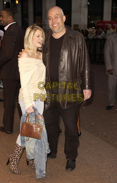 "CLIFF PARISI & GUEST.""Rollin' With The Nines"" - UK premiere at the Odeon Leicester Square, London, UK..April 19th, 2006.Ref: CAN.full length brown leather jacket pink off the shoulder top .www.capitalpictures.com.sales@capitalpictures.com.©Capital Pictures"