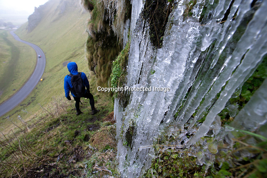 27/01/17<br /> <br /> A hiker braves slippery conditions to marvel at giant icicles on the the steep sides of Winnats Pass near Castleton in the Derbyshire Peak District this afternoon.<br /> <br /> All Rights Reserved F Stop Press Ltd. (0)1773 550665 www.fstoppress.com