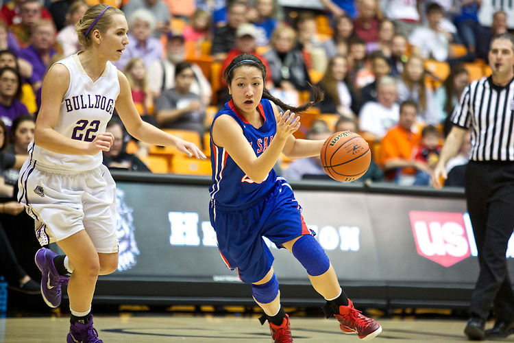 Mar 11, 2015; Portland, OR, USA;  La Salle Prep guard Shannon Tran drives on Hermiston Bulldogs guard Tavin Headings in the 5A Girls Basketball State Championship at Gill Coliseum.<br /> Photo by Jaime Valdez