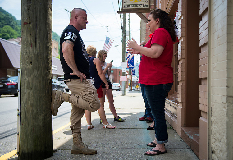 UNITED STATES - July 5: Richard Ojeda speaks with campaign volunteer Heather Ritter, 39, outside his campaign headquarters in Logan, West Virginia Thursday July 5, 2018. Ojeda is a first-term lawmaker from southern West Virginia running to represent the state's 3rd Congressional District as a Democrat. Ojeda is best known as the Democrat who voted for President Trump and who was brutally beaten in an ambush the day before the primaries. (Photo By Sarah Silbiger/CQ Roll Call)