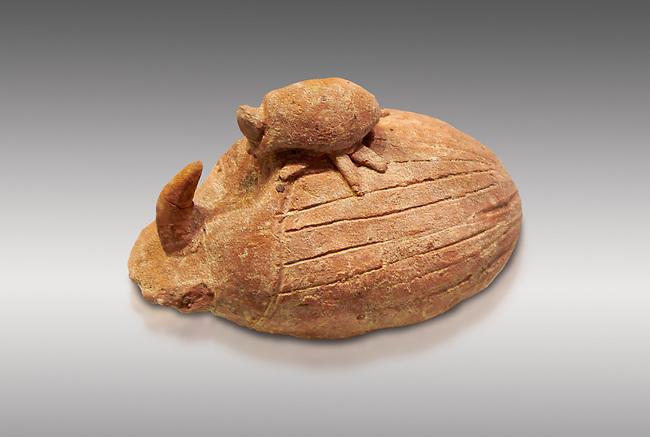 The Minoan terracotta rhinoceros beetle (Oryctes)  figurine, Piskokephalo,  1650-1500 BC; Heraklion Archaeological  Museum, grey background