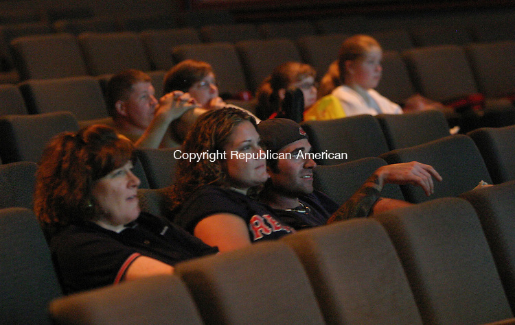 SOUTHINGTON, CT 05 July 2005 -070505BZ06-  Red Sox fans watch the game on the large screen at Showcase Cinemas in Southington Wednesday night.<br /> Jamison C. Bazinet Photo