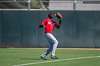 Cincinnati Reds outfielder Edwin Yon (80) pursues a fly ball in right field during an Instructional League game against the Oakland Athletics on September 29, 2017 at Lew Wolff Training Complex in Mesa, Arizona. (Zachary Lucy/Four Seam Images)