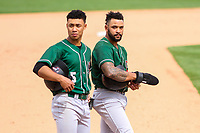 Great Lakes Loons second baseman Marcus Chiu (5) and third baseman Jared Walker (3) during a Midwest League game against the Wisconsin Timber Rattlers on May 12, 2018 at Fox Cities Stadium in Appleton, Wisconsin. Wisconsin defeated Great Lakes 3-1. (Brad Krause/Four Seam Images)