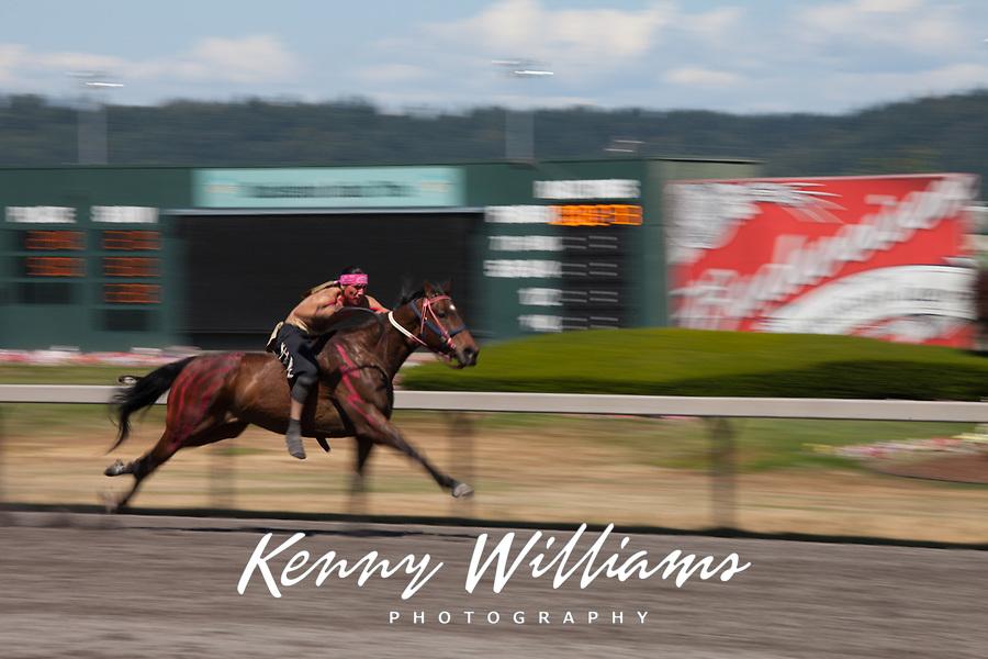 Ashton Old Elk riding brown horse with warpaint, Battle of Horse Nation, Indian Horse Relay Racing, Emerald Downs, Auburn, Washington, WA, America, USA.