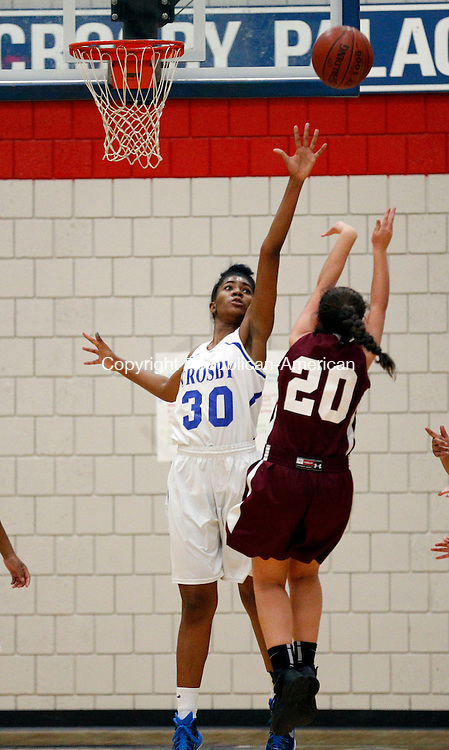 Waterbury, CT- 08 January 2016-010816CM07-  Crosby's Destin Trammell tries to block a shot from Torrington's Shannon Reardon during their NVL matchup in Waterbury on Friday.    Christopher Massa Republican-American