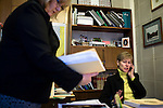March 17, 2009. Raleigh, NC.. Images from one day in the life of Deborah K. Ross, Representative for North Carolina House District 38.. 9:28 AM. Ross' legislative assistant, Margie Penven, delivers the governor's budget that will be discussed later in the day due to proposed cuts stemming from the economic crisis in the country.