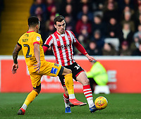 Lincoln City's Harry Toffolo clears under pressure from Northampton Town's Shay Facey<br /> <br /> Photographer Andrew Vaughan/CameraSport<br /> <br /> The EFL Sky Bet League Two - Lincoln City v Northampton Town - Saturday 9th February 2019 - Sincil Bank - Lincoln<br /> <br /> World Copyright &copy; 2019 CameraSport. All rights reserved. 43 Linden Ave. Countesthorpe. Leicester. England. LE8 5PG - Tel: +44 (0) 116 277 4147 - admin@camerasport.com - www.camerasport.com