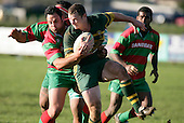K. Farrell tries to break out of the tackle of M. Poa. Counties Manukau Premier Club Rugby, Pukekohe v Waiuku  played at the Colin Lawrie field, on the 3rd of 2006.Pukekohe won 36 - 14
