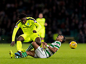 6th February 2019, Celtic Park, Glasgow, Scotland; Ladbrokes Premiership football, Celtic versus Hibernian; Emilio Izaguirre of Celtic get hurts in a sliding tackle on Darnell Johnson of Hibernian