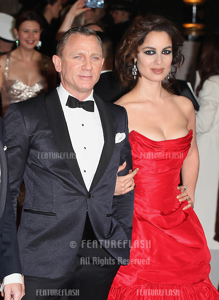 Berenice Marlohe and Daniel Craig arriving for the Royal World Premiere of 'Skyfall' at Royal Albert Hall, London. 23/10/2012 Picture by: Alexandra Glen / Featureflash