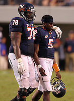 Virginia Cavaliers quarterback David Watford (5) is comforted by Virginia Cavaliers offensive tackle Morgan Moses (78) after turning over the ball on downs with second to go in the 4th quarter during the game at Scott Stadium. Virginia lost to Southern Mississippi 30-24. (Photo/Andrew Shurtleff)