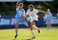 SAN DIEGO, CA - DECEMBER 02, 2012:  Ranee Premji (10) of the University kicks the ball away from Tani Costa (22) of North Carolina of Penn State University during the NCAA 2012 women's college championship match, at Torero Stadium, in San Diego, CA, on Sunday, December 02 2012. Carolina won 4-1.