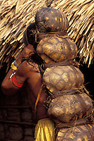 Xikrin Indigenous People, Amazon rain forest, Brazil. Hunting, man carrying the casks of fresh-water turtles.
