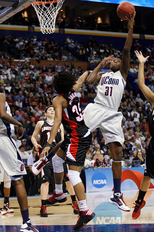 07 APR 2009:  Tina Charles (31) of the University of Connecticut pulls down a rebound against Angel McCoughtry (35) of the University of Louisville during the Division I Women's Basketball Championship held at the Scottrade Center in St. Louis, MO.  Connecticut defeated Louisville 76-54 for the national title.  Jamie Schwaberow/NCAA Photos