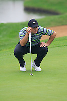 Francesco Molinari (ITA) on the 9th green during Thursday's Round 1 of the 2014 BMW Masters held at Lake Malaren, Shanghai, China 30th October 2014.<br /> Picture: Eoin Clarke www.golffile.ie