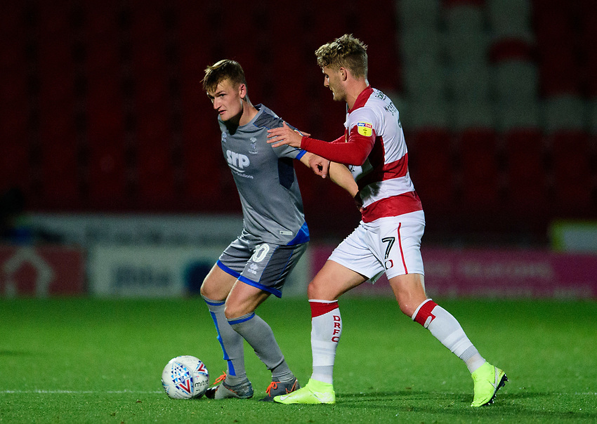 Lincoln City's Callum Connolly vies for possession with Doncaster Rovers' Kieran Sadlier<br /> <br /> Photographer Andrew Vaughan/CameraSport<br /> <br /> EFL Leasing.com Trophy - Northern Section - Group H - Doncaster Rovers v Lincoln City - Tuesday 3rd September 2019 - Keepmoat Stadium - Doncaster<br />  <br /> World Copyright © 2018 CameraSport. All rights reserved. 43 Linden Ave. Countesthorpe. Leicester. England. LE8 5PG - Tel: +44 (0) 116 277 4147 - admin@camerasport.com - www.camerasport.com