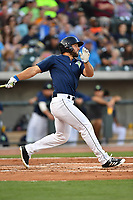 Left fielder Tim Tebow (15) of the Columbia Fireflies gets a hit in the second inning of a game against the Lexington Legends on Friday, April 21, 2017, at Spirit Communications Park in Columbia, South Carolina. Tebow went 3-for-3 with a walk and Columbia won, 5-0. (Tom Priddy/Four Seam Images)