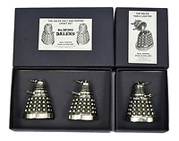 BNPS.co.uk (01202 558833)<br /> Pic: Vectis/BNPS<br /> <br /> PICTURED: Doctor Who Pewter Daleks Salt & Pepper and Doctor Who Pewter Dalek Table Lighter sold for £360. <br /> <br /> One man's epic collection of retro eighties' toys has been sold for £220,000 by his family following his death.<br /> <br /> Dr Cornel Flemming amassed more than 1,600 toy action figures and cars for franchises like Star Wars, He-Man and Transformers. <br /> <br /> The market for nostalgic toys is booming at the moment which is reflected in the prices some of the toys achieved.<br /> <br /> An unopened pack of three He-Man figures featuring He-Man, Teela and Ram Man made by Mettel sold for an incredible £12,000.