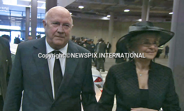 FORMER PRESIDENT F W DE KLERK AND WIFE<br /> NELSON MANDELA MEMORIAL<br /> The nation mourns Nelson Rolihlahla Mandela Memorial Service, FNB Stadium, Johannesburg, South Africa<br /> Mandatory Credit Photo: &copy;NEWSPIX INTERNATIONAL<br /> <br /> **ALL FEES PAYABLE TO: &quot;NEWSPIX INTERNATIONAL&quot;**<br /> <br /> IMMEDIATE CONFIRMATION OF USAGE REQUIRED:<br /> Newspix International, 31 Chinnery Hill, Bishop's Stortford, ENGLAND CM23 3PS<br /> Tel:+441279 324672  ; Fax: +441279656877<br /> Mobile:  07775681153<br /> e-mail: info@newspixinternational.co.uk