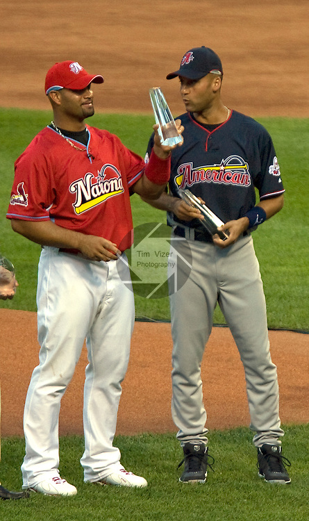 071309tvtopvotegetters.The St. Louis Cardinals Albert Pujols, and the New York Yankees Derek Jeter (right) were top vote-getters in the All Star balloting.  Here, Pujols hoists his trophy for pictures..BND/TIM VIZER
