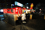 """Yatai"" food stalls, most selling ramen, or noodles served in hot broth, line the Naka River that runs through Fukuoka City, Japan. Fukuoka, which is thought to be Japan's oldest city due to its proximity to China, is famed for its Hakata brand of ramen, a dish that has its origins in China."