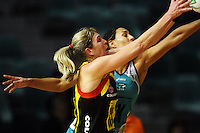 Magic goal attack Irene Van Dyk takes a pass under pressure from Geva Mentor during the ANZ Netball Championship match between the Waikato Bay of Plenty Magic and Adelaide Thunderbirds, Mystery Creek Events Centre, Hamilton, New Zealand on Sunday 19 July 2009. Photo: Dave Lintott / lintottphoto.co.nz