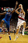 04/03/11--Blazers' Rudy Fernandez shoots over Mavericks' Brendan Haywood after being fouled by Haywood at the Rose Garden in Portland, Or.. Portland defeated Dallas 104-96..Photo by Jaime Valdez.......................................