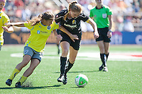 Rachel Buehler (right) battles for control against Tina DiMartino (left). FC Gold Pride defeated the Philadelphia Independence 4-0 to win the 2010 WPS Championship at Pioneer Stadium in Hayward, California on September 26th, 2010.