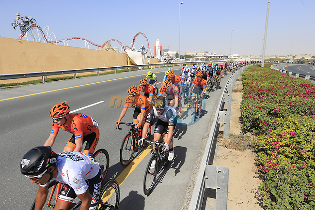 The peloton pass by Dubailand during Stage 2, the Nakheel Stage, of the 2016 Dubai Tour starting at the Dubai International Marine Club and running 188km to Palm Jumeirah Atlantis, Dubai, United Arab Emirates. 4th February 2016.<br /> Picture: Eoin Clarke | Newsfile<br /> <br /> <br /> All photos usage must carry mandatory copyright credit (&copy; Newsfile | Eoin Clarke)