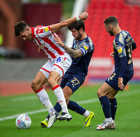 4th July 2020; Bet365 Stadium, Stoke, Staffordshire, England; English Championship Football, Stoke City versus Barnsley; Danny Batth of Stoke City under pressure from Alex Mowatt of Barnsley