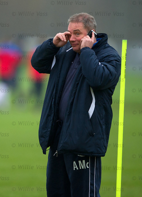 Manager Ally McCoist constantly on the phone at training