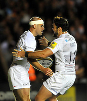 Twickenham, England. Charlie Hodgson of Saracens congratulated by Brad Barritt of Saracens on his try during the Aviva Premiership match between Harlequins and Saracens at Twickenham Stoop on September 12, 2014 in London, England.